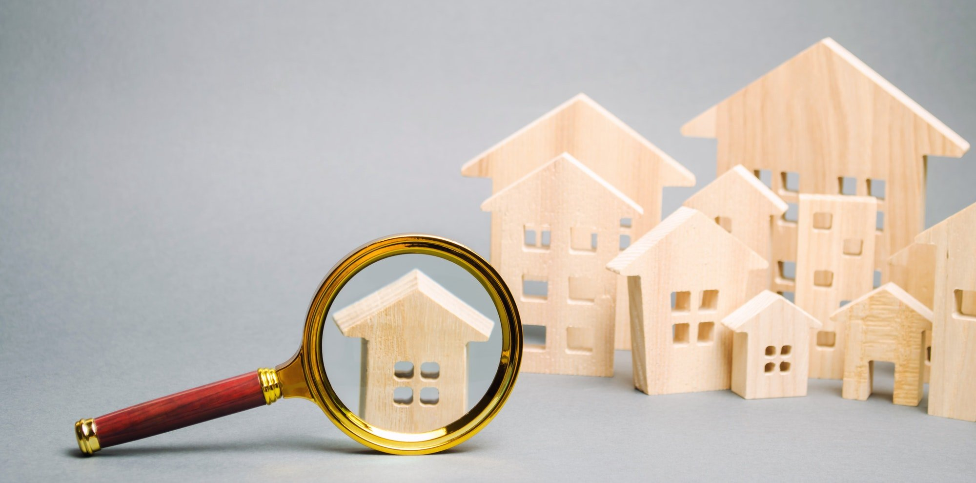 Magnifying glass and wooden houses
